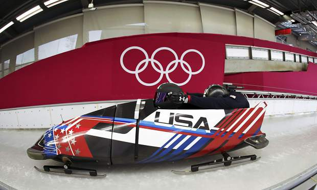 Driver Nick Cunningham and Hakeem Abdul-Saboor of the United States start a practice run during training for the two-man bobsled at the 2018 Winter Olympics in Pyeongchang, South Korea on Thursday, Feb. 15.