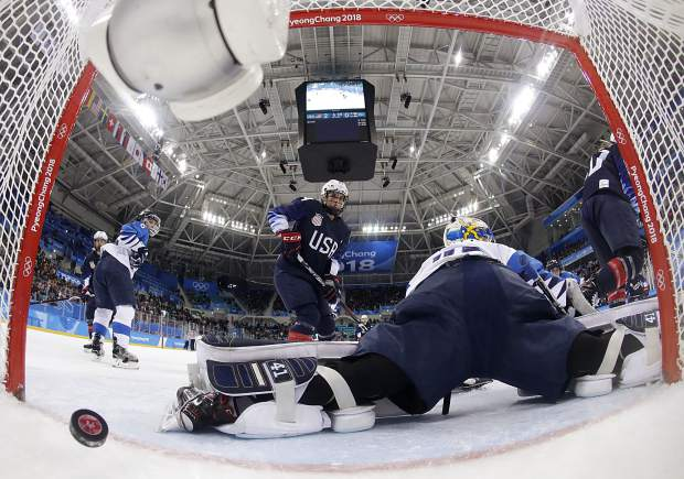 The puck shot by Jocelyne Lamoureux-Davidson, of the United States, sails past goalie Noora Raty (41), of Finland, during the second period of the semifinal round of the women's hockey game at the 2018 Winter Olympics in Gangneung, South Korea, Monday, Feb. 19, 2018. (Matt Slocum/Pool Photo via AP)