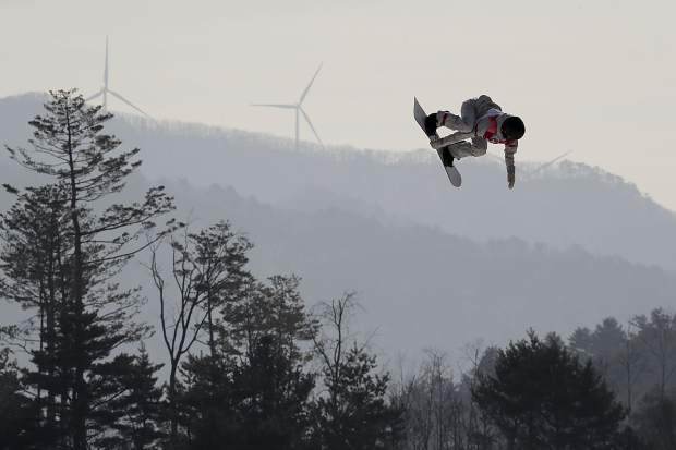 Julia Marino, of the United States, jumps during qualification for the women's big air snowboard competition at the 2018 Winter Olympics in Pyeongchang, South Korea, Monday, Feb. 19, 2018. (AP Photo/Dmitri Lovetsky)