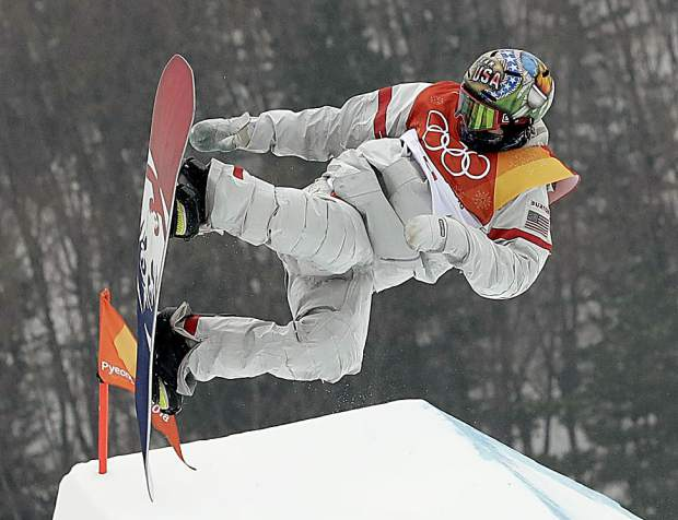 ChrisCorning, of the United States, jumps during the men's slopestyle qualifying at Phoenix Snow Park at the 2018 Winter Olympics in Pyeongchang, South Korea, Saturday, Feb. 10, 2018. (AP Photo/Lee Jin-man)