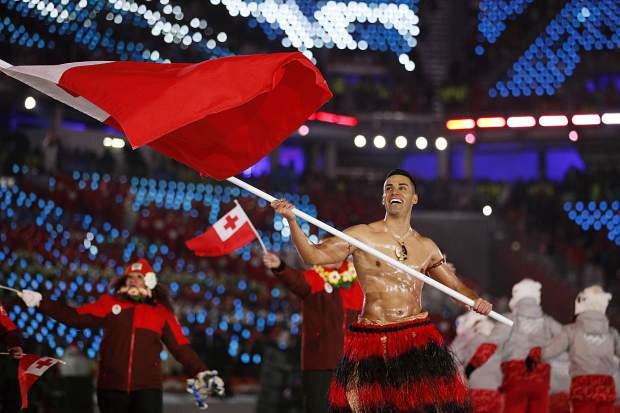 Pita Taufatofua carries the flag of Tonga during the opening ceremony of the 2018 Winter Olympics in Pyeongchang, South Korea. Taufatofua has more on his mind than just trying to compete at the Pyeongchang Olympics this week. The 34-year-old cross-country skier is concerned about his homeland after it was hit by a cyclone which destroyed Parliament House as well as churches and homes.