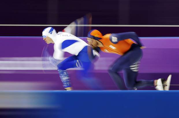 Gold medalist Kjeld Nuis of The Netherlands, right, competes against Mika Poutala of Finland, left, during the men's 1,000-meter speedskating race at the Gangneung Oval at the 2018 Winter Olympics in Gangneung, South Korea on Friday, Feb. 23.