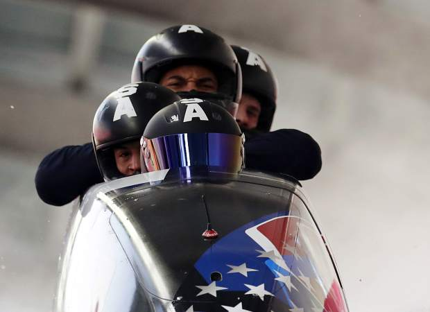 Driver Nick Cunningham, Hakeem Abdul-Saboor, Christopher Kinney, Samuel Michner of the United States brake in the finish area after a training for the four-man bobsled competition at the 2018 Winter Olympics in Pyeongchang, South Korea on Friday, Feb. 23.