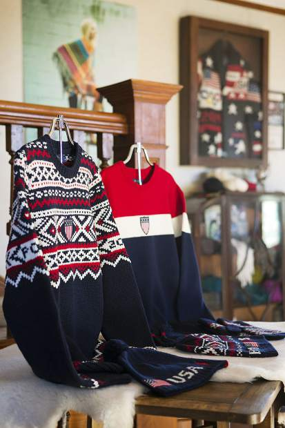 These are the opening and closing ceremony sweaters worn by Team USA Olympic athletes, coaches, and staff, displayed in the Hinton House, a showcase for some of the products made from wool from the Imperial Stock Ranch, at the ranch in Shaniko, Ore. On the wall behind them is a case containing the opening ceremony sweater for the 2014 Sochi Olympics, also made from Imperial Stock Ranch wool.