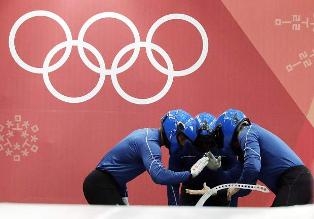 Driver Loic Costerg, Vincent Castell, Dorian Hauterville and Vincent Ricard of France start a training run for the four-man bobsled competition at the 2018 Winter Olympics in Pyeongchang, South Korea on Friday, Feb. 23.