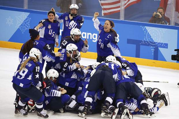 The United States players celebrate after winning the women's gold medal hockey game against Canada at the 2018 Winter Olympics in Gangneung, South Korea on Thursday, Feb. 22, 2018.