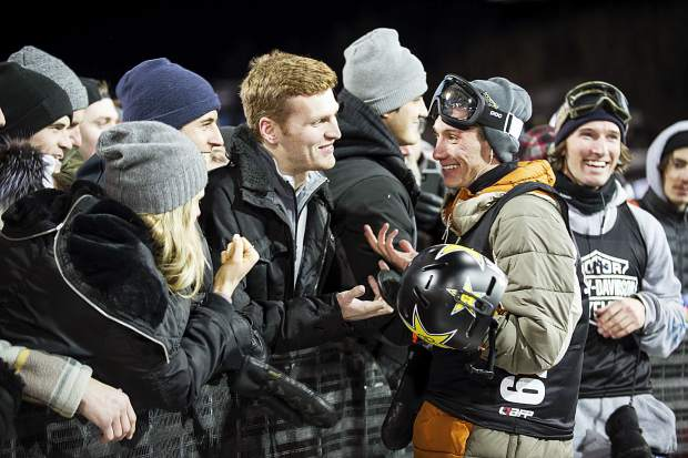 Torin Yater-Wallace, right, and Alex Ferreira chat with their friends in the crowd after their second runs in the men's ski superpipe final on Thursday, Jan. 25, 2018, in Aspen, Colo. (Anna Stonehouse/The Aspen Times via AP)
