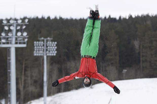 In this photo taken on Sunday, Feb. 4, 2018, a freestyle skier from Belarus practices at a national training base just north of Minsk, Belarus. The lessons learned from the vaunted Soviet gymnastics program all those years ago are still producing Olympic gold medalists, in freestyle skiing. Competitors from Belarus won the men's and women's aerials gold at the 2014 Sochi Olympics, and they will be in contention again this year in Pyeongchang.