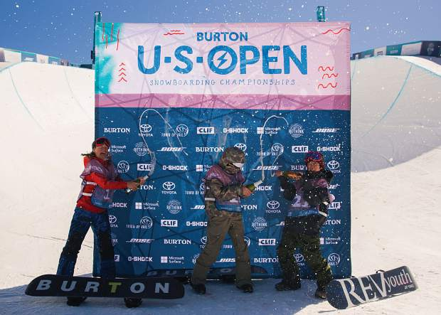 2018 Burton Open boy's Junior Jam champion Jake Canter of Evergreen, Colorado, celebrates atop the podium with second place finisher Valentino Guseli of Austria and third-place finisher Kyotara Tanaka of Japan.