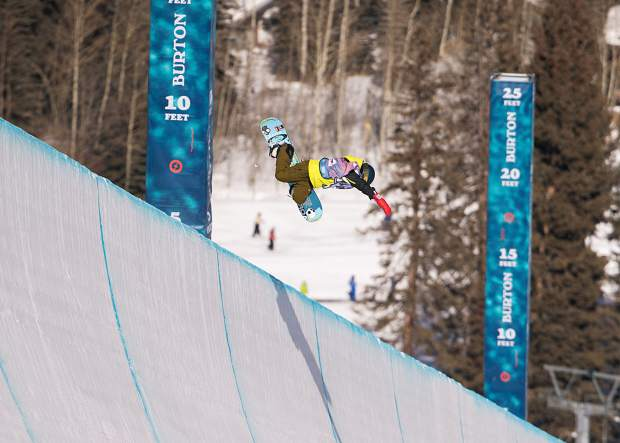 Local High Country snowboarder Jake Canter of Edwards soars high above the halfpipe at Vail Resort on Tuesday morning, on his way to winning the annual international invite-only Burton U.S. Open Junior Jam competition for competitors 14-years-of-age and younger.