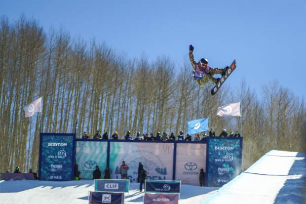 Evergreen snowboarder Jake Canter, 14, performs an indy grab while competing in the Junior Jam druing Burton U.S. Open Snowboarding Championships on Tuesday, March 6, in Vail. Canter took first and earned a spot in the Thursday, March 8, semifinal event.