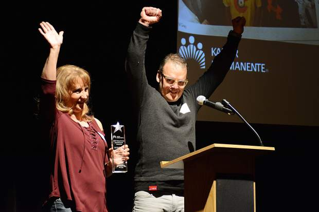 Managers Todd Andrews and Kathy McAllisters celebrate after receiving the Customer Service Award on behalf of Sanders True Value Hardware during the Business Excellence Awards ceremony Wednesday night at the Silverthorne Pavilion.