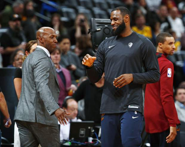 Colorado Buffalo basketball legend, announcer and retired NBA player Chauncey Billups (left) greets Cavaliers forward LeBron James, right, on March 7 in Denver. Billups ranks as having a Top 5 single-game NCAA Tournament performance in the modern history of Colorado colleges and universities.