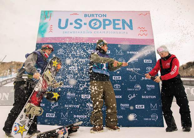 From left, second place finisher Chris Corning of Silverthorne, champion Mark McMorris of Canada and third place finisher Marcus Kleveland of Norway celebrate with a champage shower after all three podiumed at the Burton U.S. Open Snowboarding Championships men's slopestyle finals on Friday afternoon at Vail Mountain's Golden Peak.