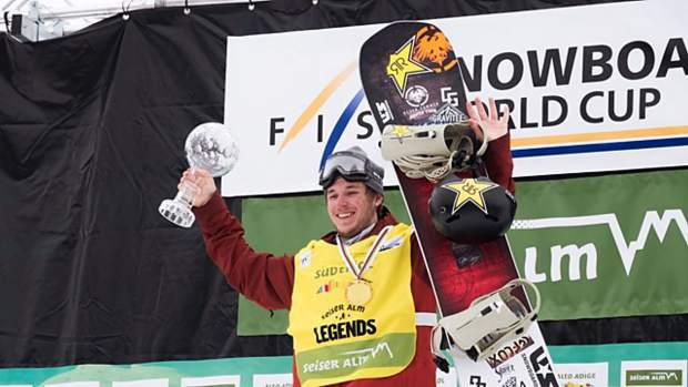Silverthorne snowboarder Chris Corning, 18, smiles while hoisting the the crystal globe in Seiser Alm, Italy, his prize for finishing the 2017-18 season atop the International Ski and Snowbord Federation World Cup slopestyle leaderboard.