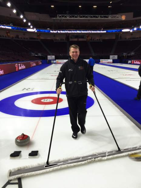 Frisco resident and native-Ontarian Rob Huehmer uses a soft-brush broom to remove any loose particals from the ice-top at a Continental Cup curling event at Orleans Arena in Las Vegas, Nevada.