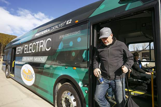 Breckenridge Mayor Erik Mamula hops off the demo Proterra electric bus Thursday, March 22, in Breckenridge. Breckenridge and Proterra partnered to demo the bus for a month to test its performance in mountain alpine conditions.