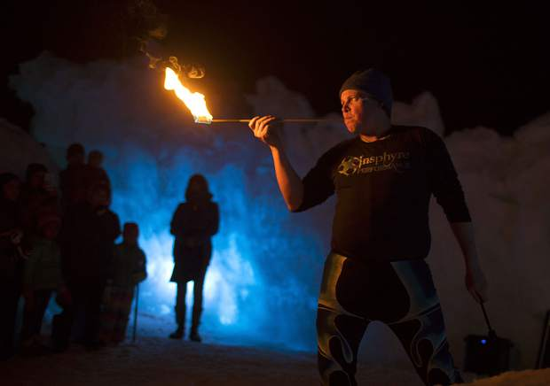 A flames get sent out by Insphyre Performance's Kevin Schaeffer during a performance in the Ice Castles Friday, March 9, in Dillon.