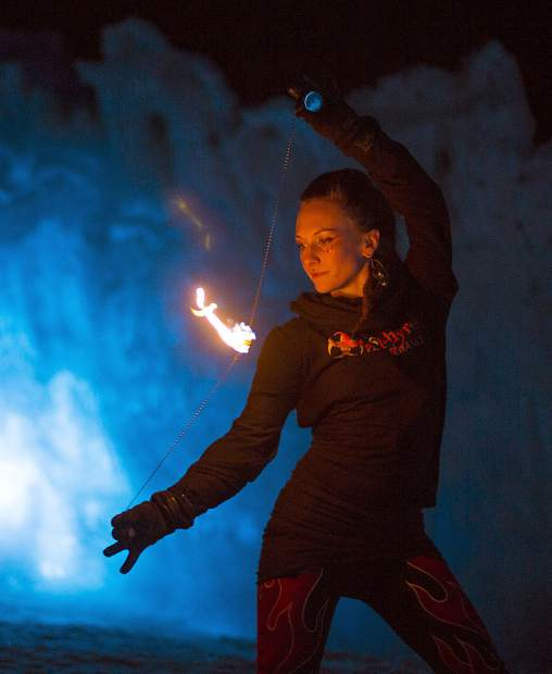 Insphyre Performance's Sara Schaeffer controls the flame during a performance in the Ice Castles Friday, March 9, in Dillon.