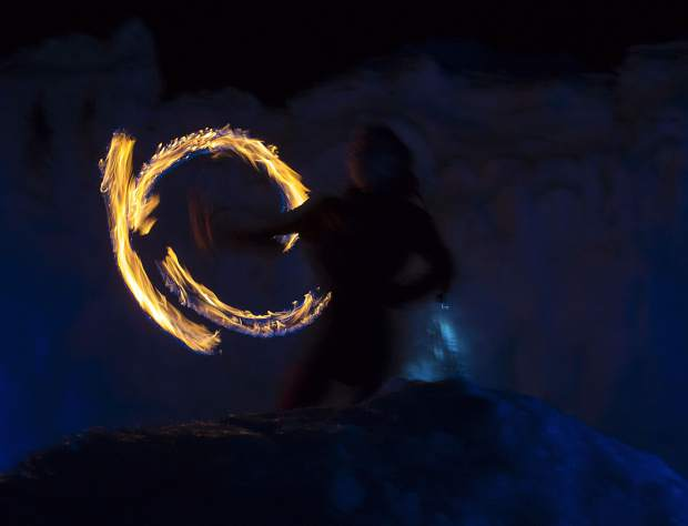 Insphyre Performance's Sara Schaeffer spins the flames during a performance in the Ice Castles Friday, March 9, in Dillon.