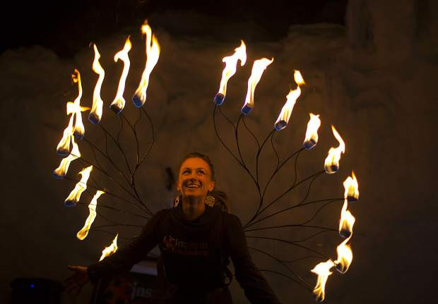 Insphyre Performance's Sara Schaeffer circled by flames during a performance in the Ice Castles Friday, March 9, in Dillon.