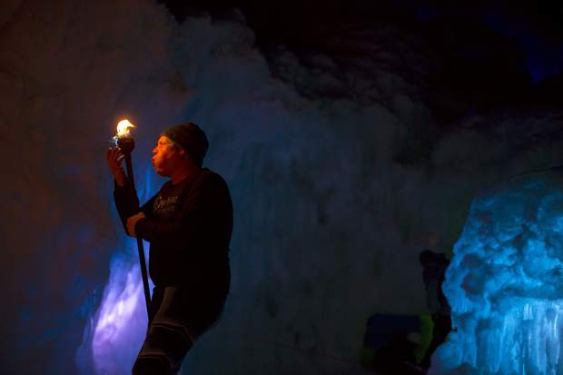 Insphyre Performance's Kevin Schaeffer blows out the remaining flame during a performance in the Ice Castles Friday, March 9, in Dillon.