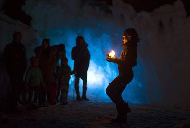 Insphyre Performance's Sara Schaeffer walks to the crowd the flames during a performance in the Ice Castles Friday, March 9, in Dillon.