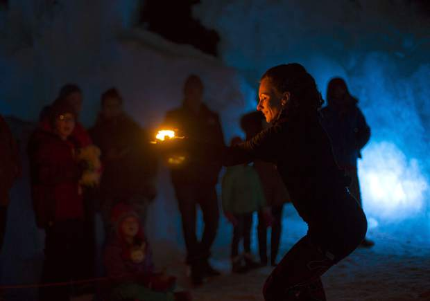 Insphyre Performance's Sara Schaeffer controls the flame in front of the crowd during a performance in the Ice Castles Friday, March 9, in Dillon.
