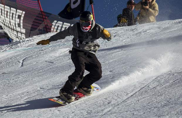 Silverthorne resident Chris Corning lands on his snowboard in the Hella Big Air competition Saturday, March 3, at Copper Mountain. Corning won the competition, his first contest since the Pyeongchang Olympics.