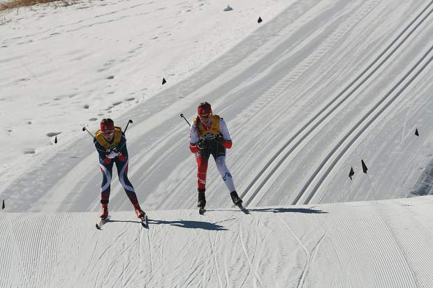 Summit Nordic Ski Club athlete Ezra Smith (right) competes in the female under-18 classic race at the U.S. Ski and Snowboard cross country junior national championships in Soldier Hollow, Utah.