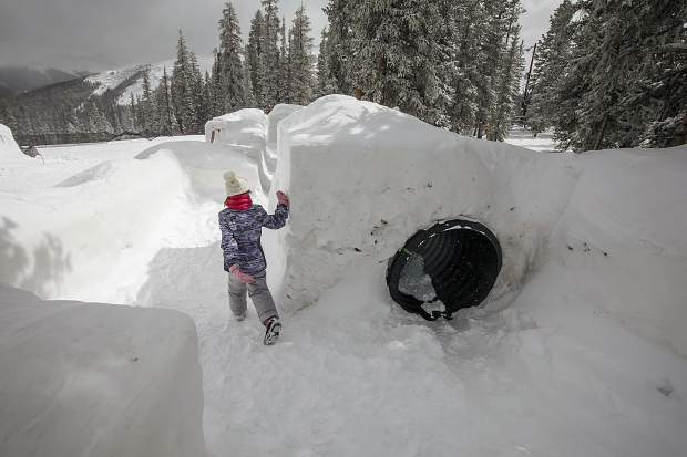 A visitor takes a break from skiing to explore the Kidtopia's Snow Fort at Keystone Resort Friday, March 16.