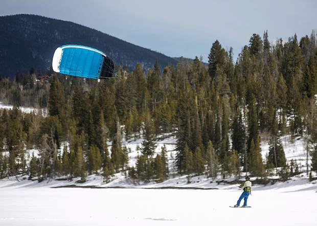 Colorado Kite Force owner and instructor Anton Rainold travels across the frozen Lake Dillon via snow kiting Friday, March 30.