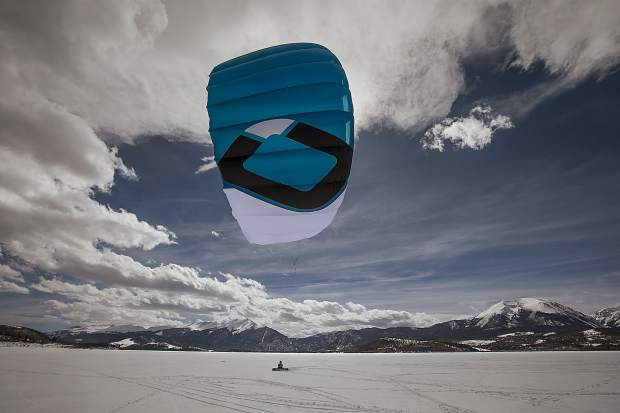 A snow kite only requires at least 6 knots of wind to carry skiers or snowboardings across the lake.