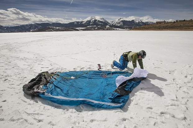 Colorado Kite Force owner and instructor Anton Rainold unfolds his snow kite Friday, March 30 on Lake Dillon.