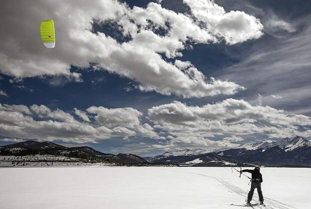 A skier takes off for his first snow kiting lesson led by Colorado Kite Force Friday, March 30, on Lake Dillon.