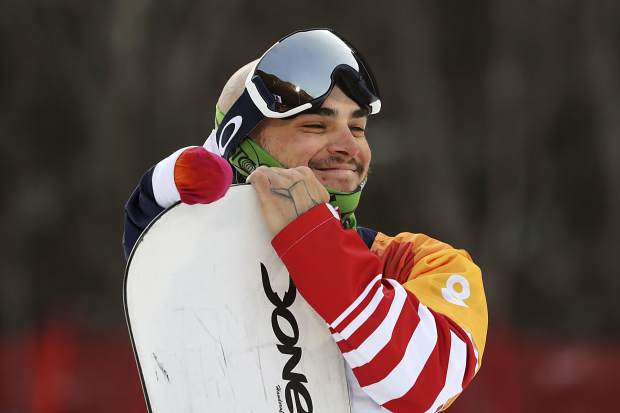 Men's Snowboard Cross SB-UL event bronze medalist Mike Minor of Frisco poses for photos during a ceremony at the 2018 Winter Paralympics in Pyeongchang, South Korea, Monday, March 12, 2018.