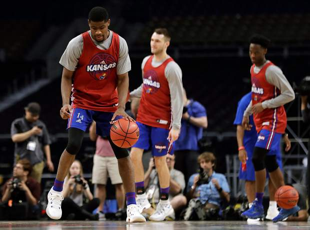 Kansas guard Malik Newman, left, dribbles up court during a practice session for the Final Four NCAA college basketball tournament, Friday, March 30, 2018, in San Antonio. (AP Photo/Eric Gay)