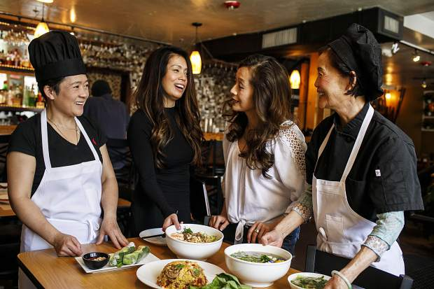 Sisters from left to right, Trang, Lua, and Khanh, with their mother Lien Nguyen interact inside their new vietnamese restaurant, Peak of Asia, Thursday, March 8, in Breckenridge