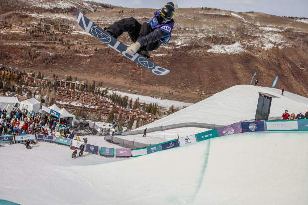 Eagle resident Jake Pates finishes up a successful halfpipe run in the Burton U.S. Open Snowboarding Championships semifinal event on Thursday, March 8, in Vail. Pates advanced to the Saturday, March 10 final in seventh position.