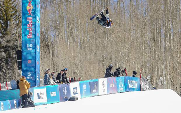 Brett Esser of Silverthorne performs a 1260 tail grab during the halfpipe semifinals at the Burton U.S. Open Snowboarding Championships on Thursday, March 8, in Vail. Esser placed 13th.