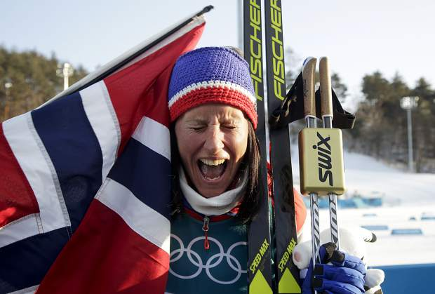 Marit Bjoergen, of Norway, celebrates after winning the gold medal in the women's 30-kilometer cross-country skiing competition at the 2018 Winter Olympics in Pyeongchang, South Korea, Sunday, Feb. 25, 2018. Bjoergen was the top individual 'platinum medalist,' according to the Summit Daily, at this year's games.