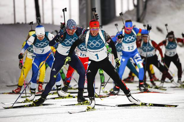 Laura Dahlmeier, of Germany, leads the pack up the hill at the start of the women's 12.5-kilometer mass start biathlon at the 2018 Winter Olympics in Pyeongchang, South Korea, Saturday, Feb. 17, 2018. Dahlmeier was three of 19 Pyeongchang gold medalists the Summit Daily has (unofficially, of course) awarded a 'platinum medal' for truly dominant performances.