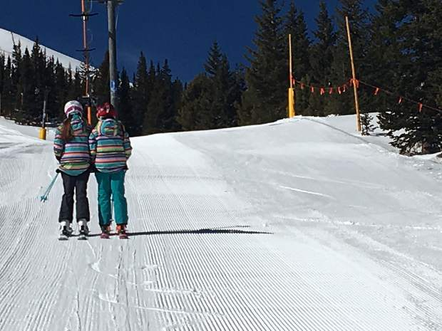 Grace and Celia Becker. Twin 11 year olds. Riding the t-bar to ski horseshoe bowl. Taken by their instructor. Todd Becker