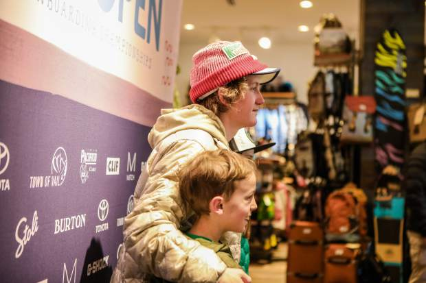 Red Gerard, Olympic slopestyle gold medalist, poses for a photo with Hugh Campbell, 10, and Margaret, 12, of East Vail, Colo., during at a meet and greet as part of the Burton U.S. Open Snowboard Championships on Thursday, March 8, in Vail. Gerard, 17-years-old and a Summit County, Colo., local, failed to qualify for the finals, but still drew hundreds to meet him in Lionshead at the Burton store.