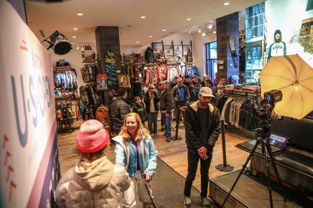 Red Gerard, Olympic slopestyle gold medalist, greets people and poses for photos at the Burton store in Lionshead on Thursday, March 8, in Vail.