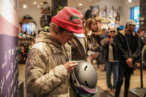 Red Gerard, Olympic slopestyle gold medalist, signs a helmet during a meet-and-greet at the Burton store in Lionshead Village on Thursday, March 8, in Vail.