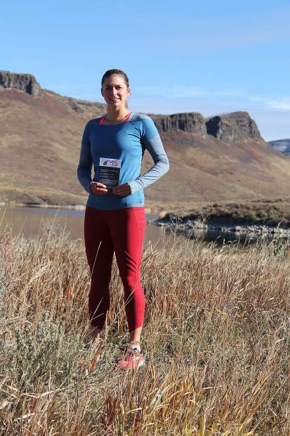 Stacy McCallister holds up her MS Run The U.S. invitation, an action photo from one of my favorite training routes in Stagecoach, and a photo from my most recent marathon, Rock 'n Roll Las Vegas, in November 2017.