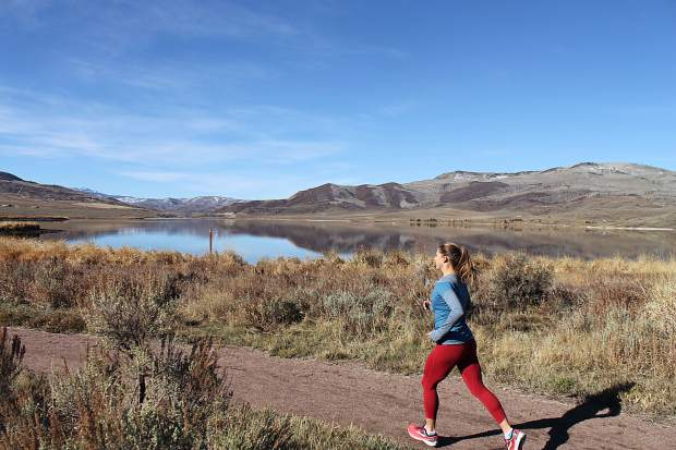 Stacy McCallister runs along one of her favorite training routes in Stagecoach.
