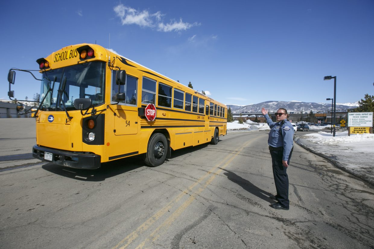 A school bus departs the Summit Middle School with the students following a threat Friday, March 2, in Frisco.