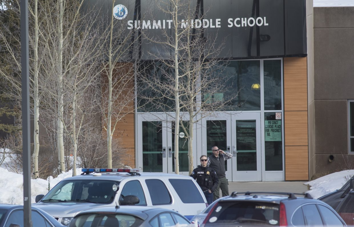 A police officer stands in front of Summit Middle School following a threat Friday, March 2, in Frisco.